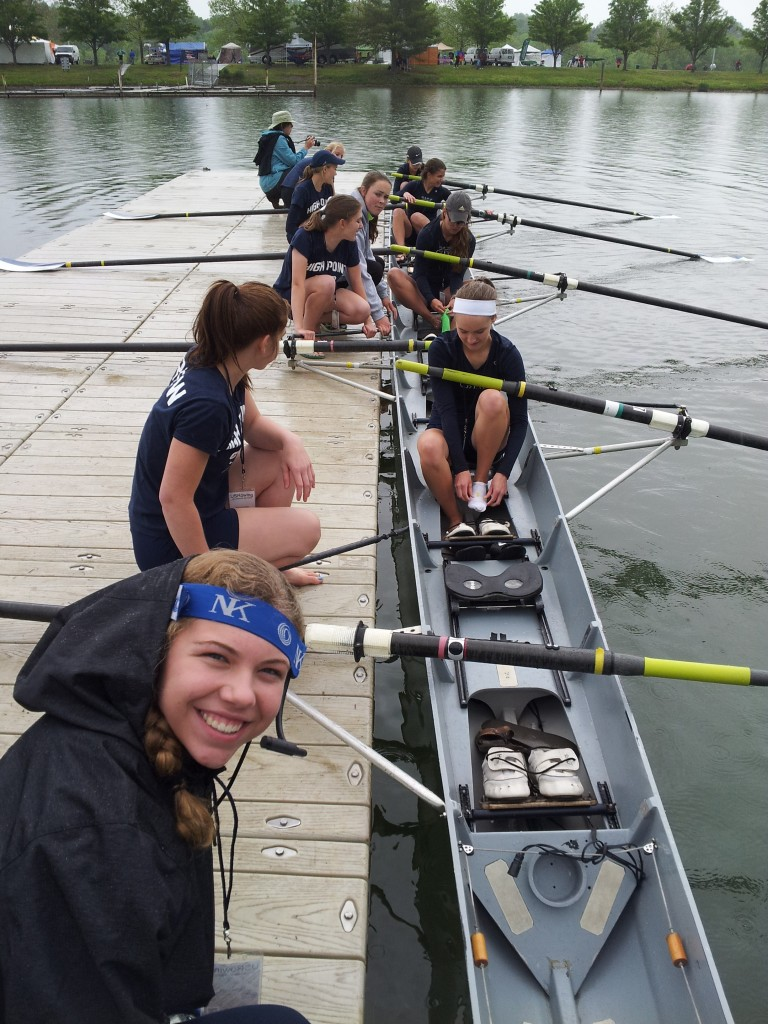 High Point's junior women's eight crew prepares its boat for launch at the USRowing Junior Regional Championships.