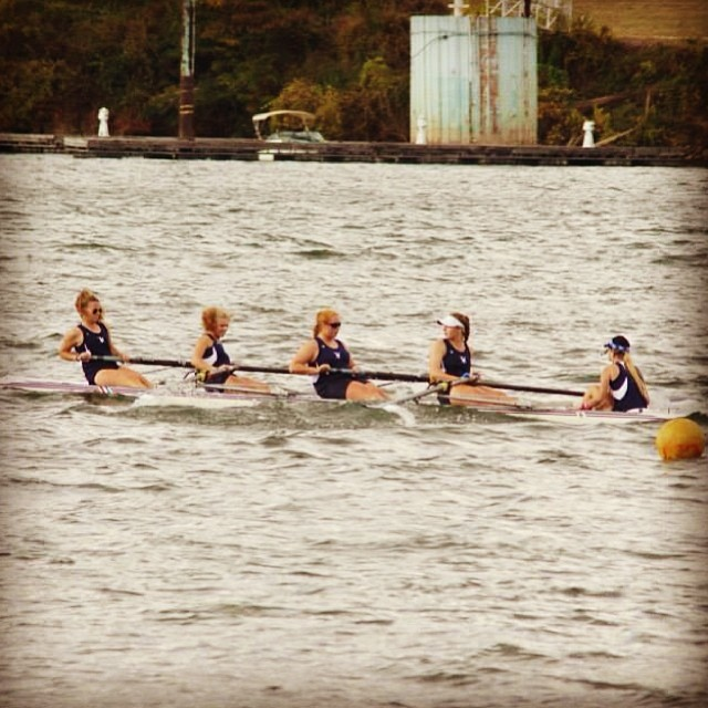 High Point's varsity four of Sarah Catto, Emma Lloyd, Katie Ognovich, Catherine Thompson and coxswain Cheyenne DeLaney continue to row despite their boat being almost completely swamped by waves in Chattanooga.