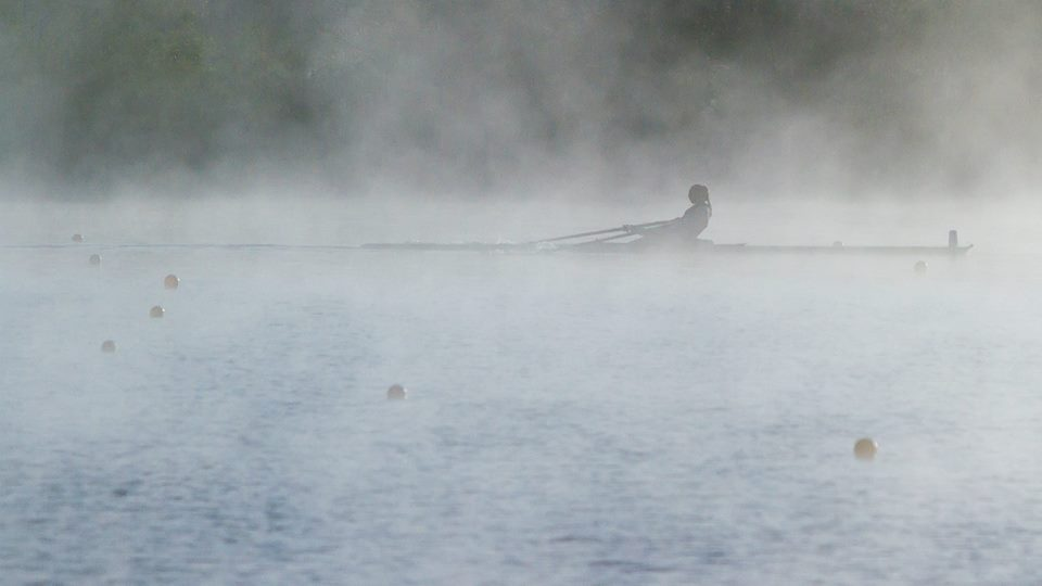Katie Ognovich emerges from dense fog on Melton Lake to lead the field in the Youth Singles Final.