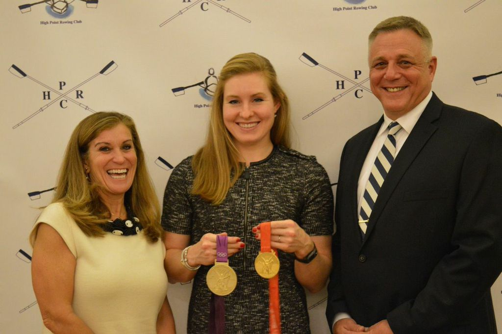Caroline Lind displays her two Olympic gold medals with Mary and Jim Hollingsworth.