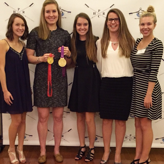 With Olympic gold in hand, Caroline Lind with High Point rowers (from left) Bethany Brake, Kim Pollard, Sarah Catto, and Emma Lloyd.