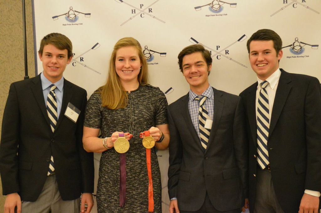 From left, rowers Adam Alt, Andrew Wright and Charles York pose with two time Olympic gold medal winner Caroline Lind at the 2014 Celebration of Rowing banquet.