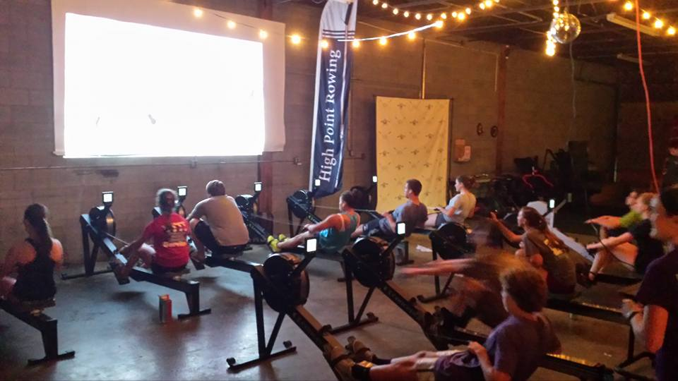Watching movies makes for a fun way to train in a group on the rowing machines, known as 'ergs.'