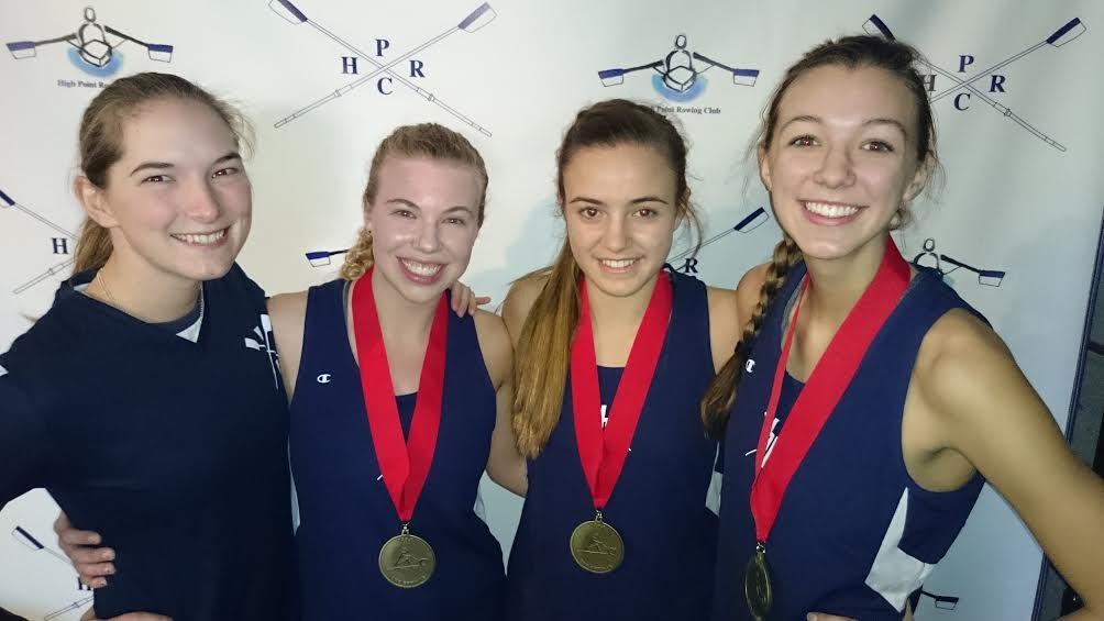 Coach Allie Davis with her winning rowers Emma Lloyd (lightweight), Jaclyn Hronich (J18), and Maddie Mullins (J16).