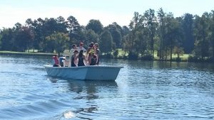High Point's varsity crew needed to be rescued after their shell had a hole punctured through it during a boat collision.
