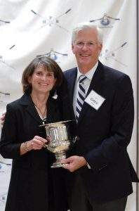 Caren and Greg York hold their silver cup for 'service above and beyond' to the youth rowing program at the 2016 Celebration of Rowing banquet at High Point Country Club.